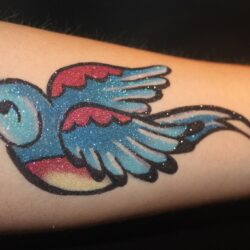 Blue_and_red_bird_tattoo - Copy